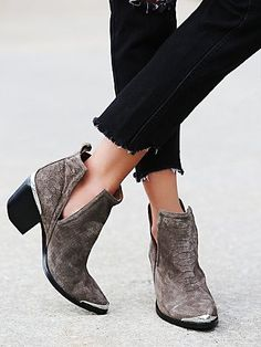 Hunt The Plains Boot | Suede ankle boots with a western-inspired design, etched metal heel and toe caps, and sculptural V-cut sides. Easily bend and mold upper to hold a coveted slouchy shape.  *By Jeffrey Campbell