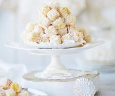high tea=These gorgeous mini lemon almond fingers are a zesty take on the classic Australian lamington. The combination of soft sponge rolled in coconut and drizzled with a sweet lemon syrup will leave you reaching for more. Square Cake Pans, Square Cakes, Fun Cupcakes, Cupcake Cakes, Lamingtons Recipe, Cheesy Cauliflower Bake, Yummy Treats, Sweet Treats, Checkerboard Cake