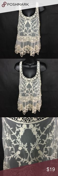 Express Lace Top~Amazing 💋~NWOT~Cream Amazing lace top in a size medium. NWOT. Condition: NWT NWOT ✅ GREAT GOOD FAIR  I'm always open for a good offer, don't hesitate to ask if it's reasonable. My prices can change daily. Please if you are unsure about the size, I will measure and get back to you ASAP. I would like to avoid low ratings because of potential sizing issues, when I will gladly measure for you If you have any questions let me know. Happy Shopping 😊 Express Tops Tank Tops