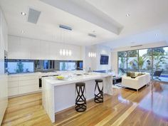 interior, White Kitchen Color Scheme With Laminate Flooring And White Kitchen Island Design And White Kitchen Units Design With Glass Kitchen Window And White Sofa For Living Room Design Ideas With Glass Door: Remarkable Interior Home Remodeling Ideas
