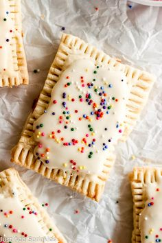 You can make your own pop tarts at home!!! And they're so much yummier than the store bought. These have a thick strawberry filling and are coated with a yummy vanilla glaze and of course, garnished with sprinkles! #poptarts #homemade #justaddsprinkles