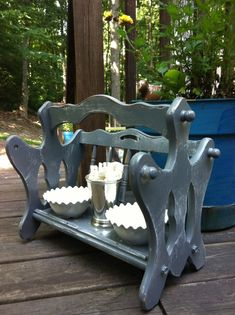 A repurposed magazine rack makes for a great food & water bowl holder for the puppy!
