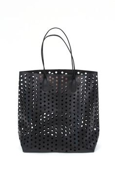 Rachel Comey Punched Tote, 630, available at Beklina.