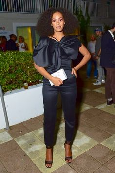 black silk jumpsuit + white clutch + black mesh heels