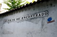 """""""Finally I've found you"""" -- Favorite little things about Córdoba: the street art. Instead of cool graffiti or tagged images, someone has gone around over the years and posted Spanish inspirational quotes and typical andalúz phrases in inky black type on the white-washed walls of abandoned buildings in the old quarter."""