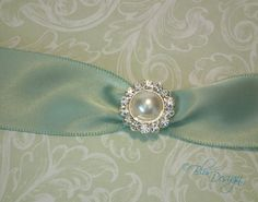 Vintage-inspired wedding invitation in soft mint-green by Blis Design