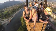 Hot Air Balloon Ride over Vang Vieng while traveling Laos. The Married Wanderers capture their bucketlist moment all on GoPro Balloon Rides, Hot Air Balloon, Travel Couple, Laos, Balloons, In This Moment, Adventure, Couples, Youtube