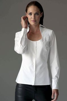 https://www.cityblis.com/6074/item/12533 | PIA WHITE - $129 by The Shirt Company | Featuring a perfect horse-shoe shape neckline the Pia shirt is both flattering and versatile for work and weekends.  Team with a gold or silver delicate chain necklace to compliment your décolletage.  Pleated front panels are cut diagonally to slim and enlongate the body.  Sleeves and back... | #Tops/Blouses
