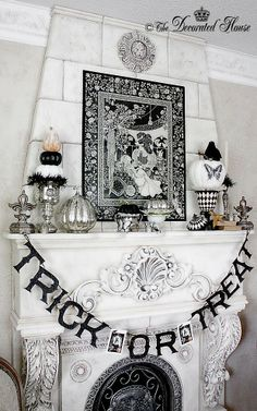 The Decorated House Halloween Mantel 2013. Halloween Decor Decorating. It's all about the beauty of black and white. Lots of fun diy ideas to make your Halloween pretty.
