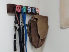 Love these faucet handles used for coat hooks. Multicolored are great. 26 Useful DIY Wall Hook Ideas