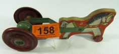 "Lot 158 in the 3.18.14 online & live auction! Wonderful vintage push / pull toy made by General Toy Products of Canada. The ""Horse Chime"", estimated to have been made in 1948, features a wooden horse pulling a bell chime cart. The bell still rings when you move the toy back and forth. The horse appears to be a decal glued to a wood block. He has two wooden wheels in the front, a green tin harness and bell, and red tin wheels in the rear. Wheels are embossed ""Made in Canada"". #Toy #POGAuction"
