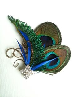 Customize this Multi purpose  Peacock Decor for a hair piece, clutch purse,sash, broach and. $22.00, via Etsy.