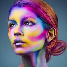 OIL-SLICK RAINBOW This look may require a sand art hair dye job to match, but what could be cooler than a neon-bright, oil-slicked rainbow face? Makeup by @sarahmcgbeauty