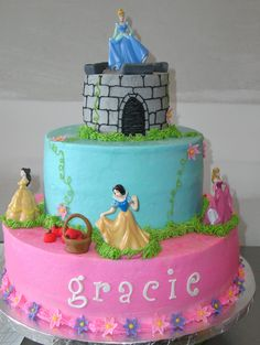 Disney Princess Cake - 12, 8 and 4 inch tiers.    Buttercream with fondant accents.