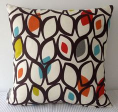 Color palette for my new home-  Retro cedar eyelets in dark brown, red, orange, green and turquoise cushion cover