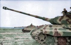 "France 1944 Two Panzer VI ""Tiger II"" (King Tiger) with Porsche turret on level ground."