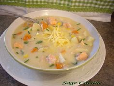 This is creamy good, yet low fat and good for you.This chowder is easy to make and requires only one pot. The salmon comes out tender and sweet. Use your favourite cheese, but gouda is extra special. Add 1/4 tsp Harissa(chili paste) for a special taste sensation.