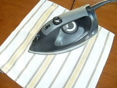 How to get stains out of wood...Place a cotton cloth directly over the stain and with a dry iron (NO STEAM!) press down for several seconds on the cloth. Remove and check the stain. Keep doing until the watermarks are completely gone. It could take a minute or two to get the stain out completely.