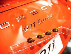 Custom dark chocolates handpainted in Lava Orange to match this PTS 911 Turbo for a special event at Porsche Center Puerto Rico.  #indulge #hauteservices #hautechocolates #couturechocolates #customchocolates #chocolatier #handpaintedchocolates #darkchocolate #darkchocolates #luxurychocolates #porsche #porscheturbo #991turbo #911turbo #lavaorange #pts #garageeuropa #gomezhermanos #porschepuertorico #porschecenterpuertorico #revistalujo #lujopuertorico #lujopr