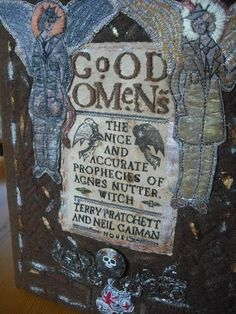 """Knitted and embroidered cover for """"Good Omens"""" by Muriel Baker for World Book Night. - #discworld #pratchett #crafty"""