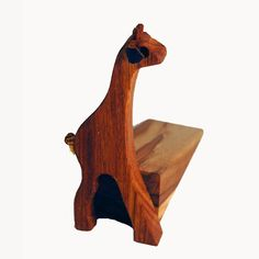 Wooden Giraffe Door Wedge They make these in elephant and hippo as well.) From The Africa House! Giraffe, Elephant, Living Room Accessories, Door Stop, Wooden Doors, Home Living Room, Cushion Covers, Wood Carving, Africa