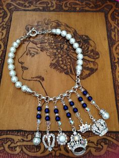 September Challenge Crown Jeweled Bib Necklace. SP components and chain. Czech cobalt pearls and crystal AB crystals. Design by Renie Hoffman.