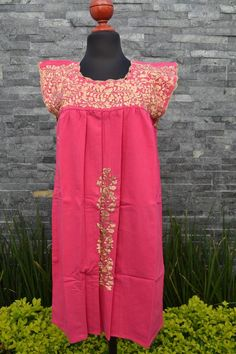 This lovely Pink dress was handmade in Mexico. The beautiful colorful flowers were embroidered by hand, so each one is unique. You will love wearing this comfortable cotton dress with short sleeves. It is perfect for a hot summer day. This dress comes just above or below the knee, depending on how Mexican Embroidered Dress, Embroidered Clothes, Mexican Skirts, Flower Shirt, Ethnic Dress, Handmade Clothes, Flower Dresses, Cotton Dresses, Pink Dress