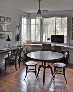 cool stools for a kitchen or meeting space... love the light fixture, too