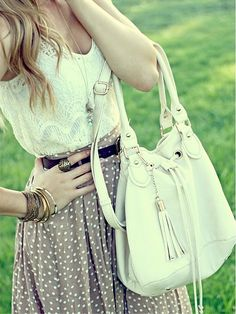 Adorable w/ a white, lace shirt underneath and minus purse