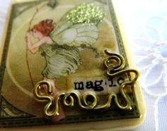 this one's my favorite pixie pendant on her site. :) altered rummikub game pieces. SOOOO cool!