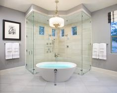 Double corner shower,  & spa jet tub set in the middle of them. .. bathroom of My dreams!