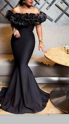 c2bb3fb8f4 Sleeveless floor length black dress with ruffles round the neck and sleeve.  Dinner Dresses,