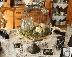 Black and white Halloween table setting with birdcage center piece by French Laundry