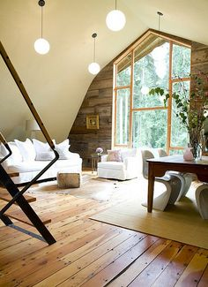 Renovated barn - simple light fixtures look so good in here - and the rough wood and windows complement each other beautifully.