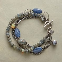 """TEMPO BRACELET--Three strands of semiprecious stones—kyanite, opal and gray pearl—offer a varying backbeat to one slender sterling silver chain. Sterling toggle. USA. Exclusive. 7-1/2"""" L."""
