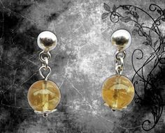 Earring * Model: Amber * Material: 950 Silver law, natural semiprecious stones No.10 yellow rock crystal. * Stock: 01 pair Shop Now $15.00
