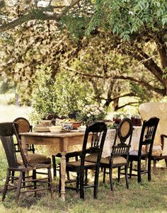 """When friends drop in for lunch, Robin gathers a medley of old china and chairs at a long table under the chinaberry tree. """"I have no two friends alike, so why should their chairs be alike?"""" she reasons. #countryliving #gardens"""