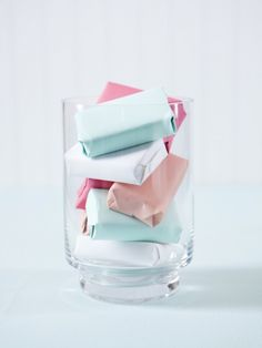 Wrap up bars of soap in beautiful wrapping paper and put in a glass container in your bathroom!