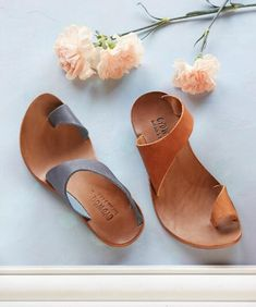 You'll cherish the chic style of these curved leather strap sandals by CYDWOQ.