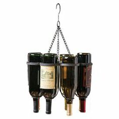 """Display your favorite vintages in style with this lovely hanging rack, showcasing 6 wine slots and a pewter finish.    Product: Wine rackConstruction Material: MetalColor: PewterFeatures: Holds six wine bottlesDimensions: 18.75"""" H x 13.8"""" DiameterNote: Bottles not included"""