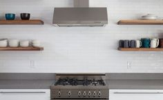 Timeless White Kitchen | Both on trend and timeless this classic white kitchen backsplash features an offset layout in our 2 x 8 Tile size. | Installation Gallery | Fireclay Tile | Tile pattern shown: Offset | Tile color shown: White Gloss