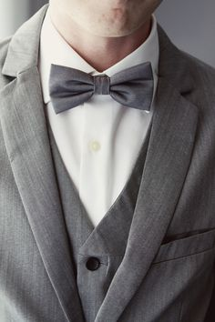 gray bow tie and a three-piece suit for the groom