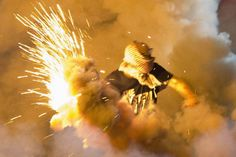 Adding to the lawlessness: A 'protestor' throws back a smoke bomb in a clash with police in Ferguson, Mo Ferguson Riot, Kalashnikov Rifle, Ak 74, Jackie Brown, Assault Rifle, Black History, Horror, Cry, Police