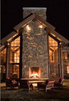 This defining outside fireplace makes the outside feel like part of the inside of the house and expands the space.