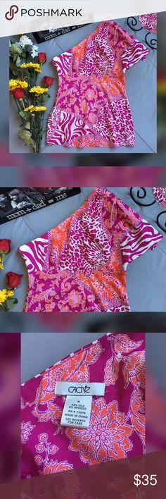 "CACHE' ONE SHOULDER TOP IN VERY GOOD PRE-OWNED CONDITION. TINY SNAG OR TWO IN THE SILK SHOWN IN PHOTO 5 BY ZIPPER AREA *COLORS ARE CLOSET TO ORCHID & ORANGE IN MY OPINION  *SALE IS FOR TOP ONLY!  *92% SILK 8% SPANDEX  *SIDE ZIP & CLASP CLOSURE  BUST APPROX 32"" SHOULDER TO WAIST APPROX 27"" STORED IN NON-SMOKING PET FREE HOME Cache Tops"