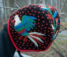 Traditional baby hat from Dalarna in Sweden, but with pattern from Otomi in Mexico instead. Woolen embroidery! by Elin Jantze