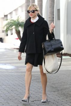 Reese Witherspoon wearing Saint Laurent Duffle Bag and Saint Laurent Classic Paris Pumps