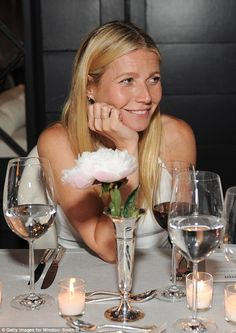 Ethereal decor: The actress sat down to a meal at a table decorated in white with candles ...