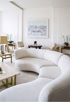 A Parisian apartment, designed by Pierre Yovanovitch: A Vladimir Kagan sofa and Edward Wormley armchairs, both c.1950s. / Wordpress