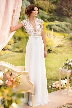 gorgeous deep v-neck wedding dress with lace bodice | i am in love with this long, lace wedding dress and its cap sleeves